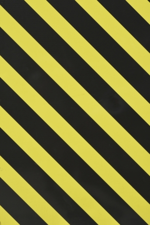 padlocked: Yellow and black diagonal stripes as an abstract pattern background Stock Photo