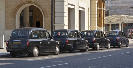 rank: Four London black taxi cabs outside Kings Cross station