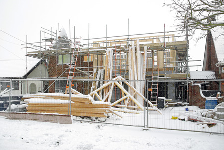 halted: House alterations halted due to snowy winter weather conditions Stock Photo