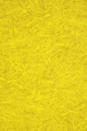 hoarding: Yellow painted wood particle board hoarding panel as background image Stock Photo