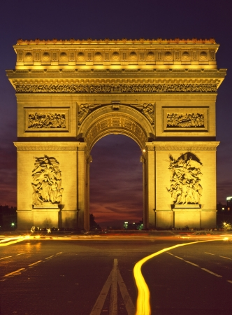 charles de gaulle: Paris floodlit Arc De Triomphe and the Place Charles de Gaulle with traffic trails and sunset