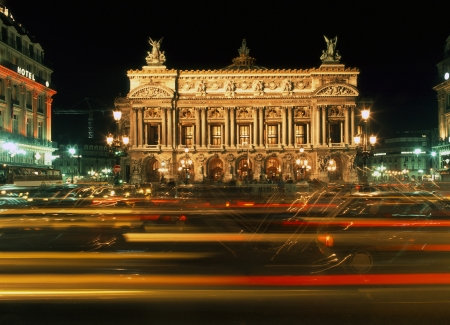 Busy night scene outside the floodlit Paris Opera House photo