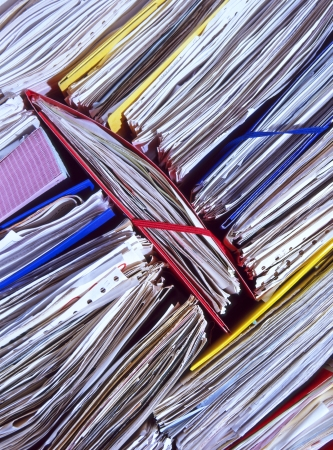 disorganized: An untidy stack of office documents and files