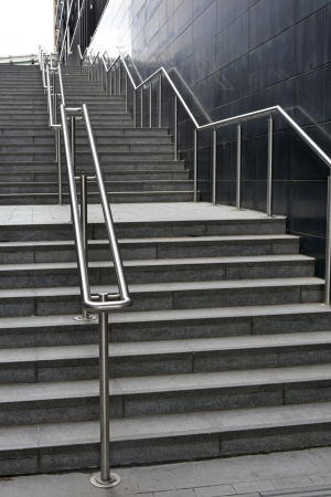 handrails: Flights of steps and stainless steel handrails Stock Photo