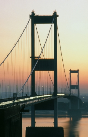 The original River Severn Bridge at dusk looking towards the Welsh shoreline photo
