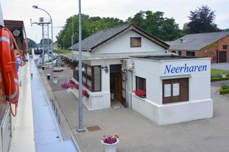 onboard: Neerharen canal lock keepers office in Belgium seen from onboard tour boat
