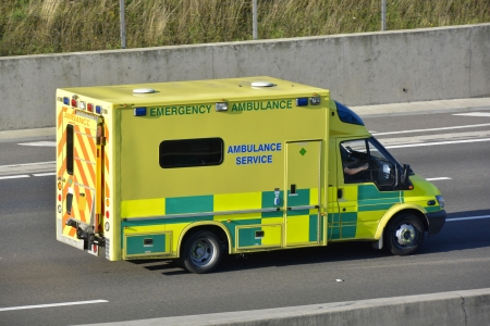 british isles: Emergency Ambulance vehicle driving along motorway