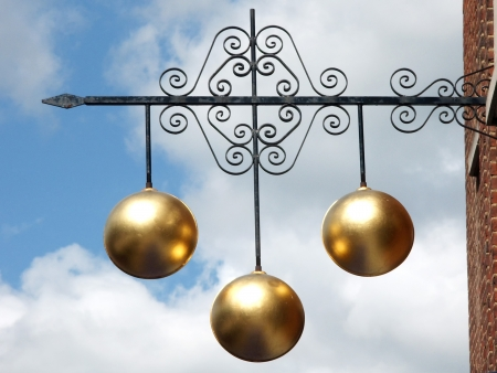 metalwork: Pawnbroker sign fixed to wall above shop premises Stock Photo