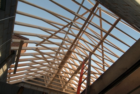 rafters: Detached house under construction, skywards view of prefabricated roof trusses