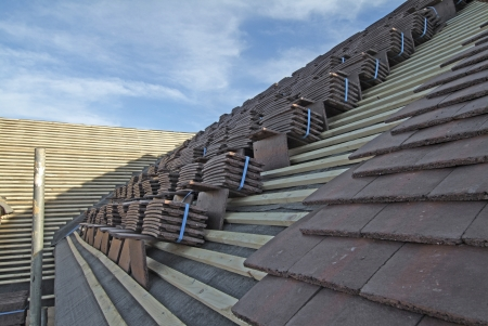 pitched roof: Concrete plain roof tiles on new house under construction