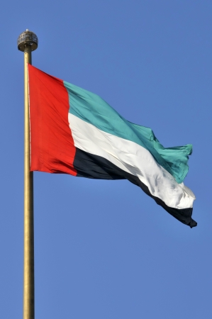 United Arab Emirates flag at Jumeirah against clear blue sky photo