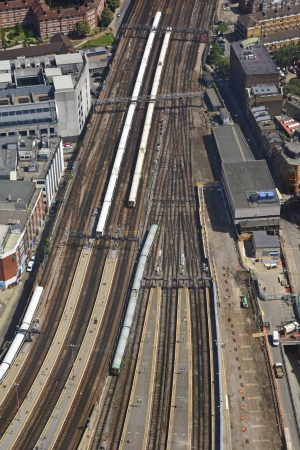 departing: Aerial view of trains arriving and departing London Bridge station platforms
