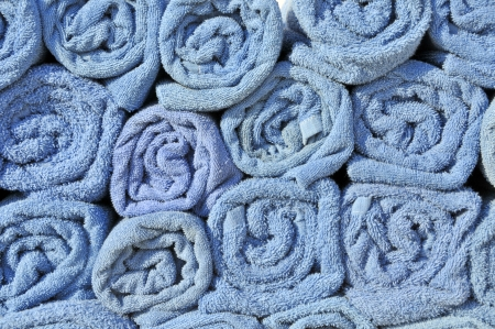 toweling: Stack of clean blue rolled up towels