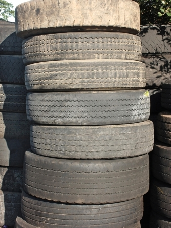 deemed: Stack of worn or damaged commercial vehicle tyres deemed to be beyond legal reuse or repair and awaiting proper disposal