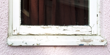 softwood: Neglected softwood window cill and frame in need of maintenance Stock Photo