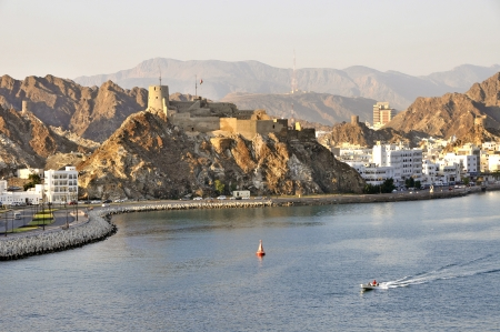 muscat: Hilltop fort on rocky outcrop overlooking the Muttrah Corniche and harbour in Muscat Oman