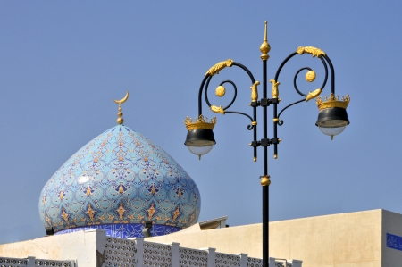 muttrah: Muttrah Muscat Oman decorated street lamp with dome of mosque beyond