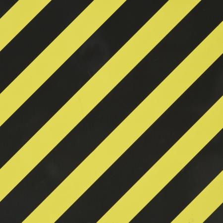 diagonal stripes: Yellow and black diagonal stripes as an abstract pattern