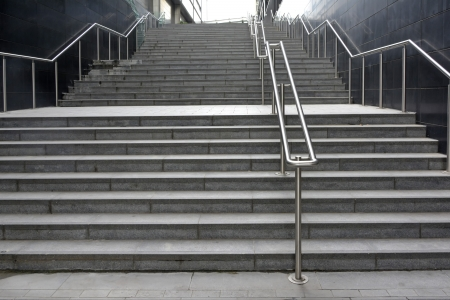 handrails: Long wide flight of outdoor steps with stainless steel handrails