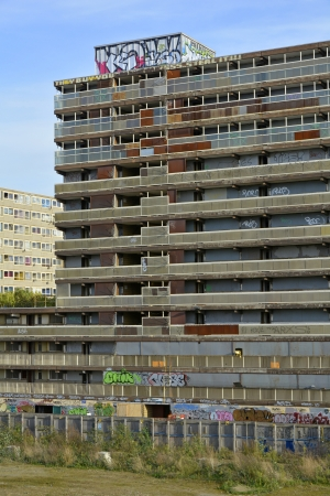 run down: High rise concrete council estate social housing blocks boarded up and graffitied prior to demolition
