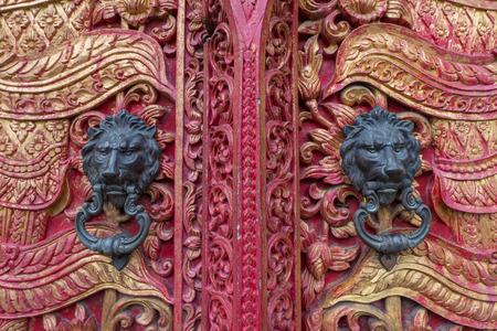 wood carving door: ancient door with  doorknob lion