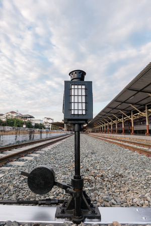 lamp on the pole: Old lamp pole (signal light) in railway station