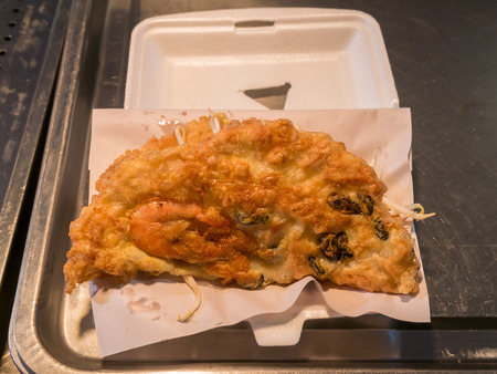 foam box: Fried oyster omelette (mussel pancakes) in foam box by Thailand night street food vendor Stock Photo