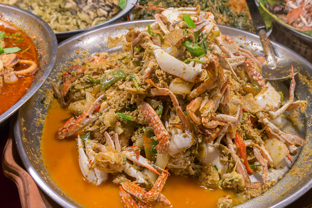 crab: Fried crab in yellow curry, Stir-fried crab curry. Thailand night street food Stock Photo