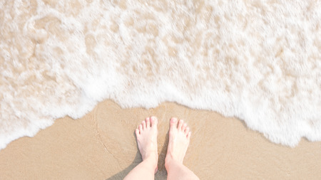 soften: Top view foot on the beach with Blur and soften Sea foam, Hipster style