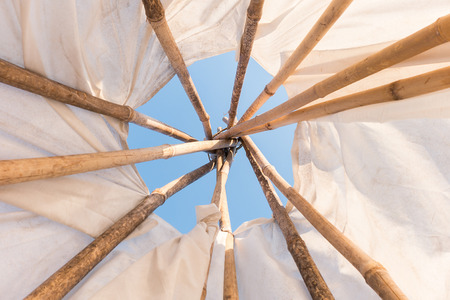 dwelling: Look up in sky inside a Native American Indian tepee.