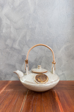 chinese tea pot: Chinese tea pot on wooden table. Copy space Stock Photo