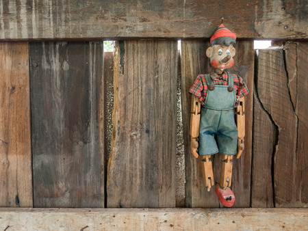 pinocchio: Old Pinocchio wooden marionette hang on wall
