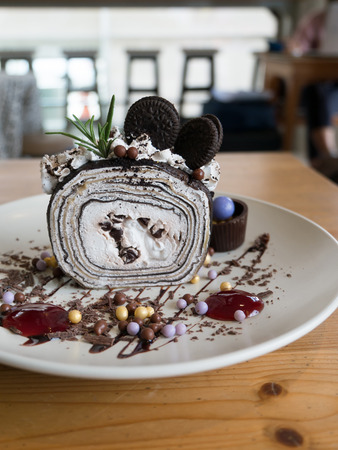 Chocolate crepe roll with cafe background