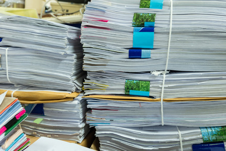 manage clutter: Close up stack of document at office.
