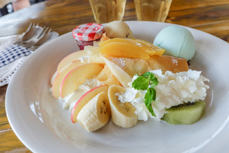 crepe with fresh fruit  on wooden table Stock Photo