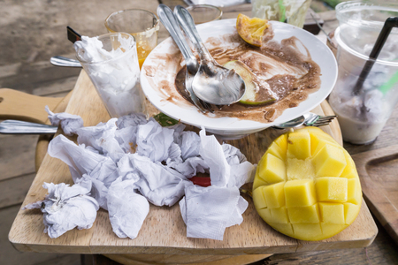 Messy table after eating dessert on the wooden table