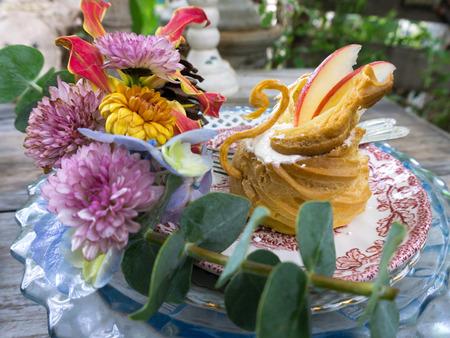 swan choux cream dish decorate with flower Stock Photo
