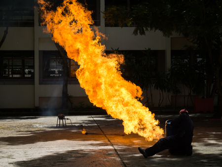 The fireman demonstrates how to suppress fire from gas tanks