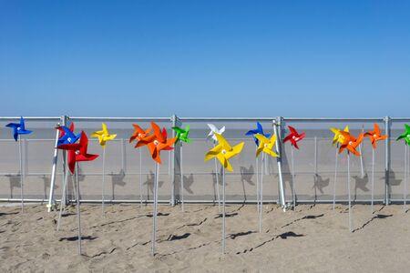 colorful windmill toy standing on Iho Tewoo Beach, Jeju island, South Korea Foto de archivo