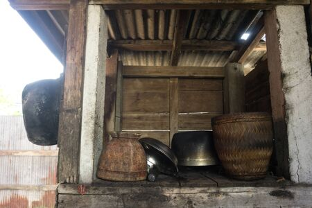 Old wooden pantry storage in countryside of Thailand