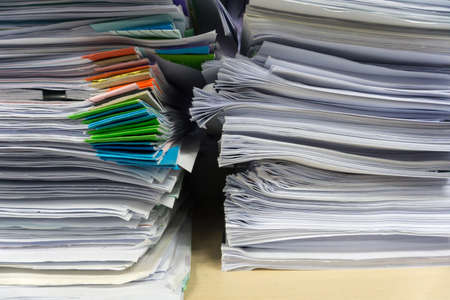 Close up stack of document at office.