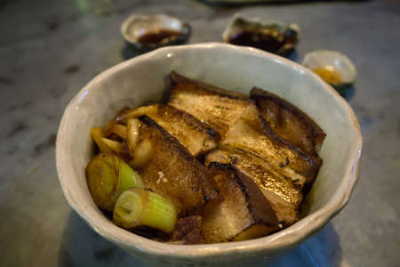 "Japanese pork rice call as ""Chashuyaki don"". It is a grilled pork on rice. Фото со стока"