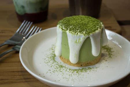 Matcha green tea cheesecake in the cafe Фото со стока