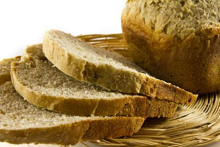 Loaf of bread and bread slices isolated on white background