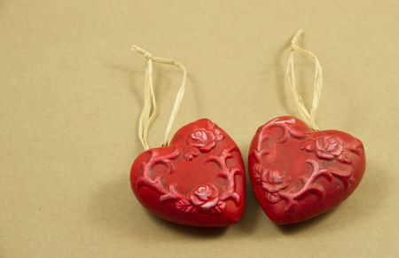 Two red hearts made of clay