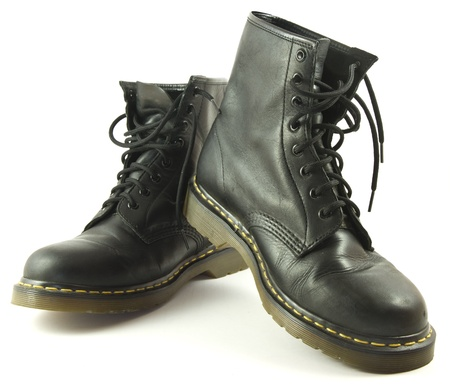 Black leather boots isolated on a white background