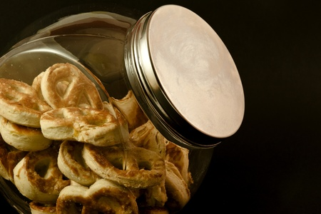 Pretzels in a glass jar with black background Stock Photo