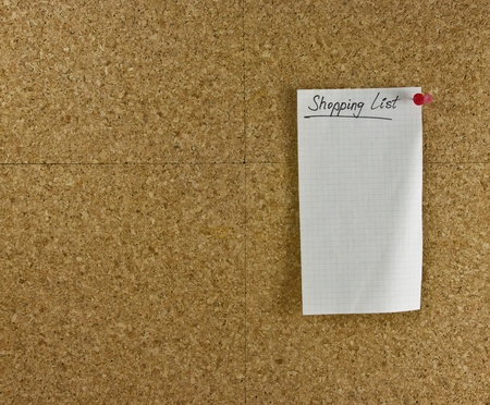 Shopping list blank paper pinned to a corkboard