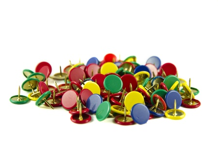 Colourful thumbtacks isolated on a white background
