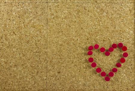 Corkboard background with heart photo